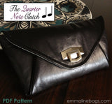 The Quarter Note Clutch Black Leather