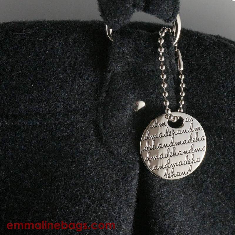 "Metal Hanging Tag: Small Circle ""handmade"" in Nickel on Charcoal Bag"