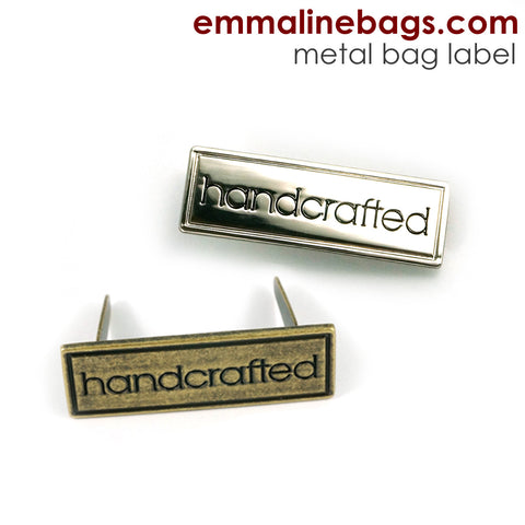 "Metal Bag Label: ""Handcrafted"" with Border in 2 Finishes"