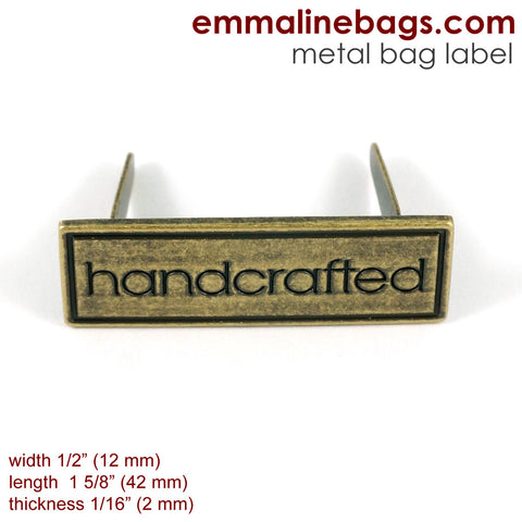 "Metal Bag Label: ""Handcrafted"" with Border in Antique Brass"