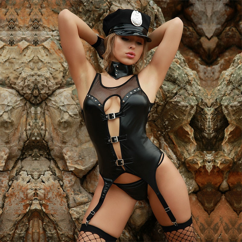 Beautiful woman in erotic, sexy leather police costume. Adult play