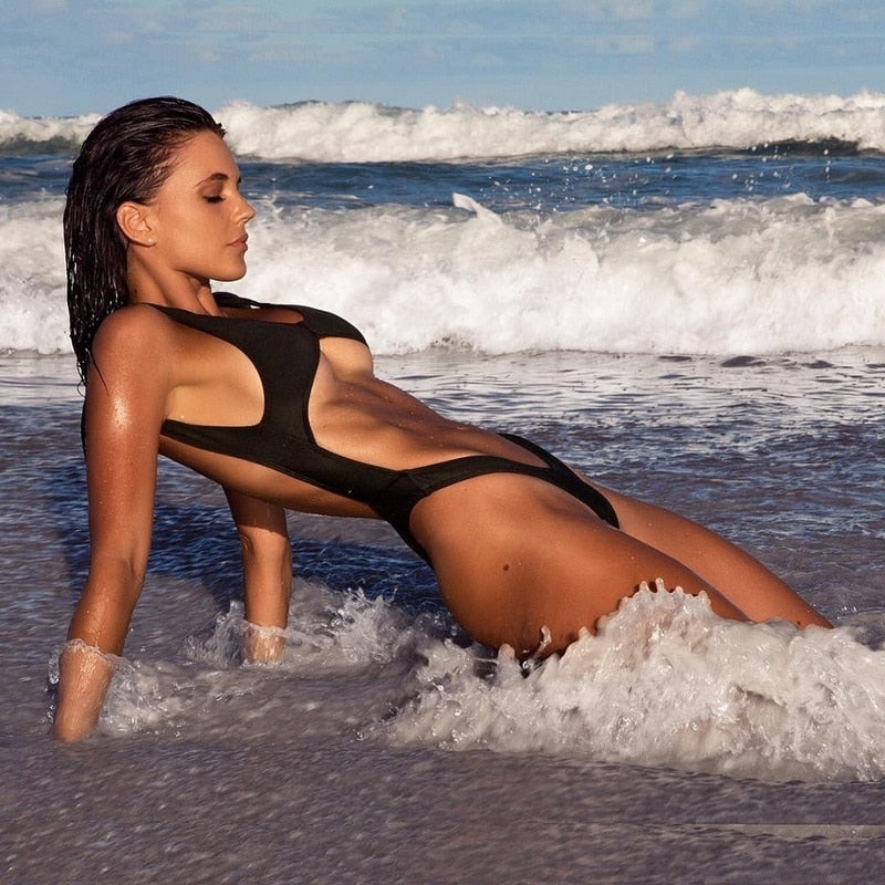 Beautiful Woman Splashing in the Waves on a Beach