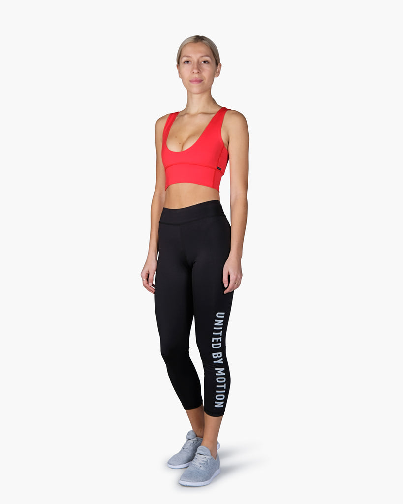 Reversible Switch Sports Bra in Red, Classic United By Motion Tights, Chill Pill Training Shoes in Grey