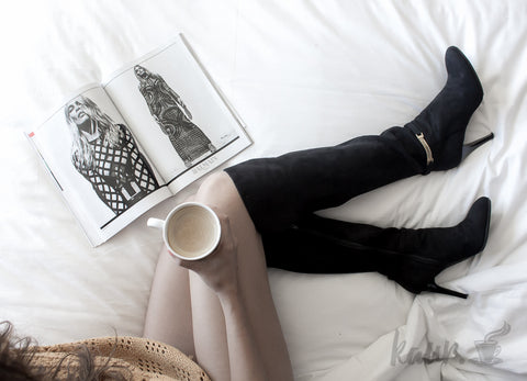 coffee in high boots photo coffee on the bed