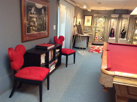 he also has two whimsical red mickey chairs from home dcor designer ethan allenu0027s line of disney furniture