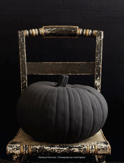 black pumpkin on chair