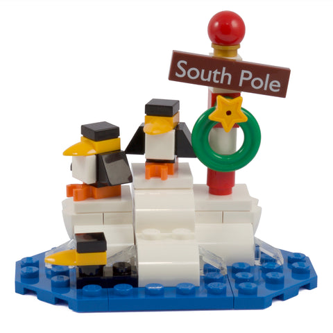 Penguins on Iceberg & South Pole sign