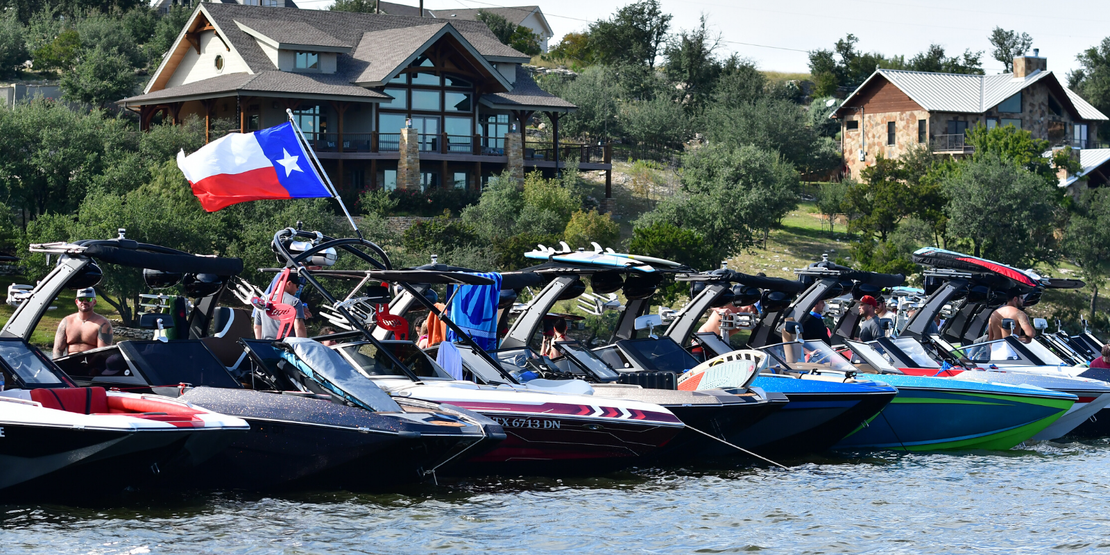 line of wake boats on the lake