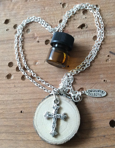 BENEFITS Samaritan's Purse // Cross Essential Oil Diffuser Necklace Made with Organic Wood