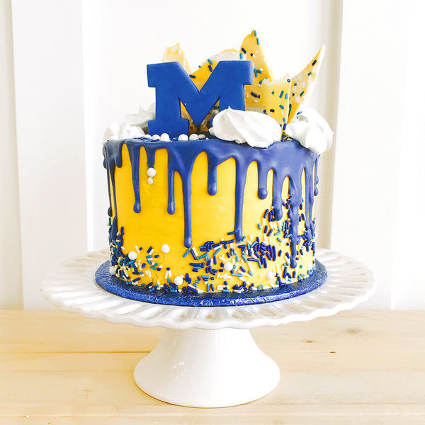 U Of M Overloaded Drip Cake The Home Bakery