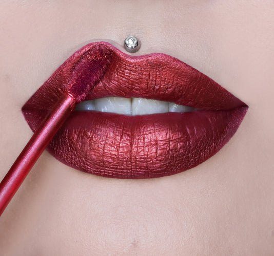 VELOUR LIQUID LIPSTICK - POINSETTIA ON MODEL