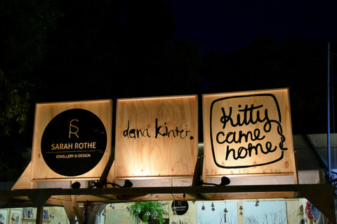 Night-time WOMAD signs for Kitty Came Home, Sarah Rothe Jewellery and Dana Kinter Art