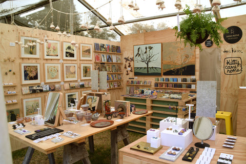 Well-stocked WOMAD stall display: Kitty Came Home, Sarah Rothe Jewellery and Dana Kinter Art