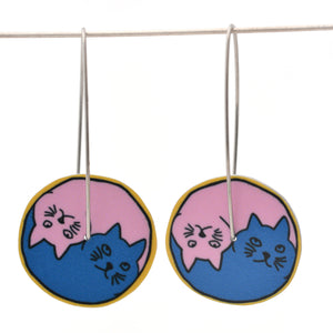 Yin Yang Cats circle earrings in pink and blue with a yellow outer edge, approximately 24mm round. Aluminium, with surgical stainless steel drop hooks approximately 40mm in length.
