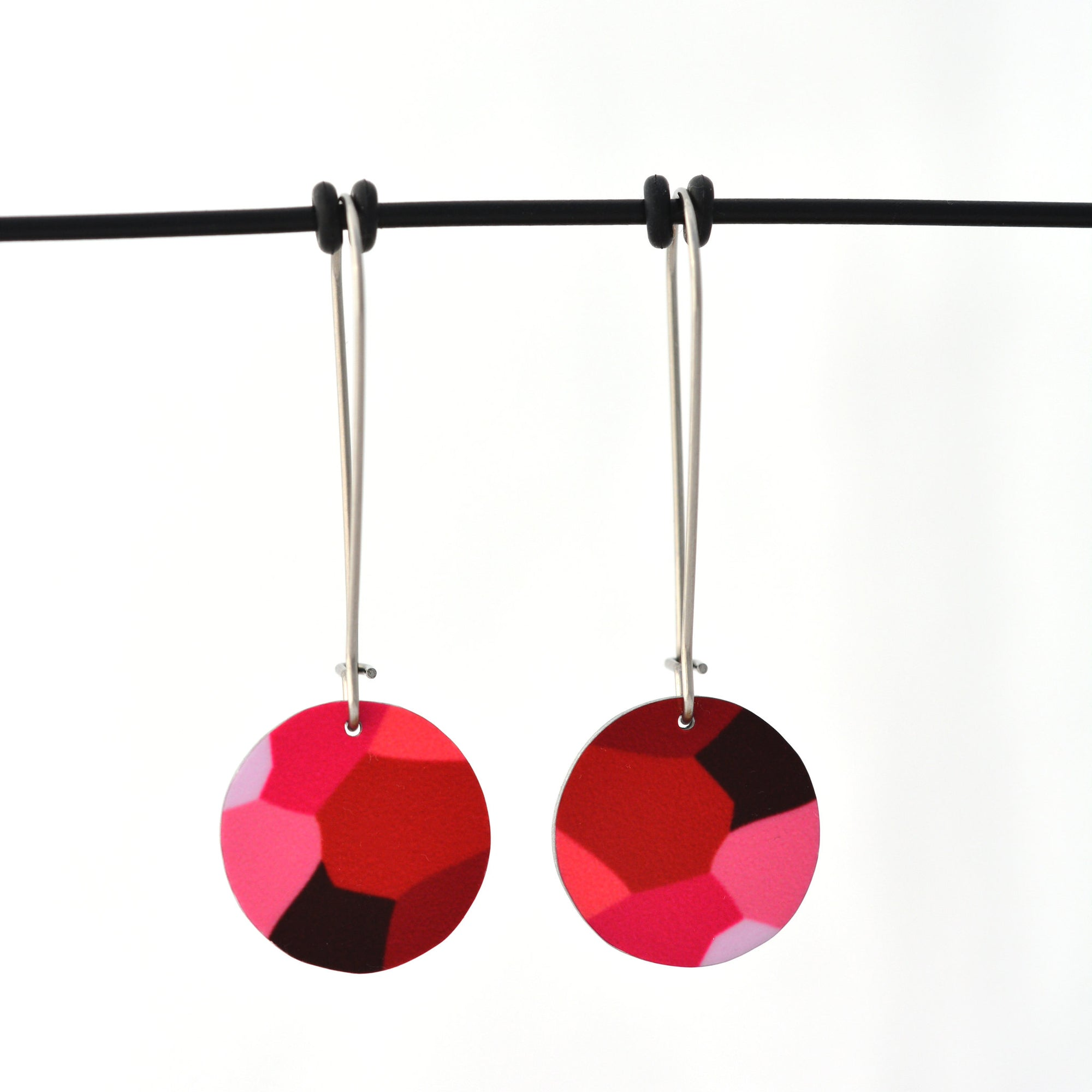 Pink facets circle earrings; designed from the organic details inside Geraldton Wax flowers. Approximately 16mm in diameter. Aluminium, with surgical stainless steel drop hooks approximately 33mm in length.