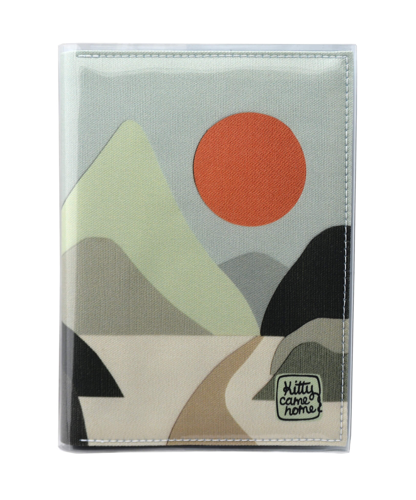 This is an image of the front of a Kitty Came Home A5 journal in the 'Moonlight drive' design by Satin and Tat. An orange moon in a pale green sky above a landscape of green hued hills. A path leads between the hills toward the distant mountains.