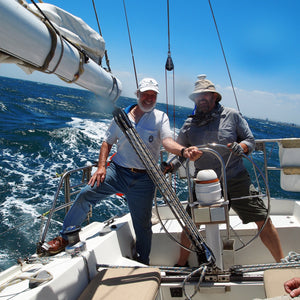 Designer-maker Farley and friend Arthur aboard the yacht Teal II