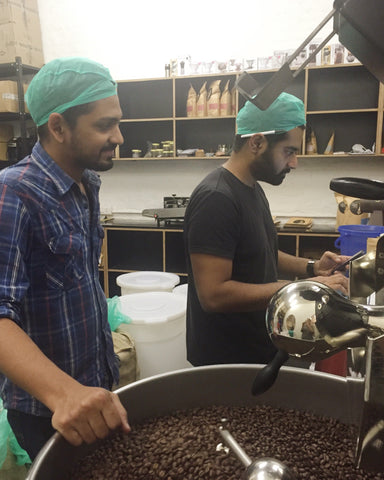 Mithilesh (Right) and Raymond (Left) Roasting a Batch of Coffee