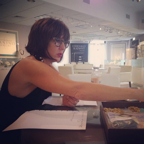 Jewelry Designer Catherine Canino reviews first samples for an upcoming show.