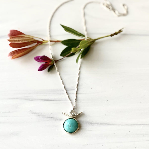 Sterling Silver Necklace with Amazonite and White Topaz on marble background with rose flower