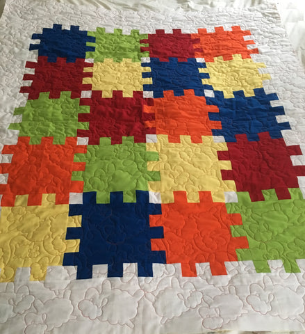puzzle piece quilt with sheep quilt design