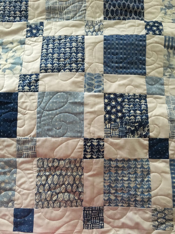 long arm quilting of blue squares quilt