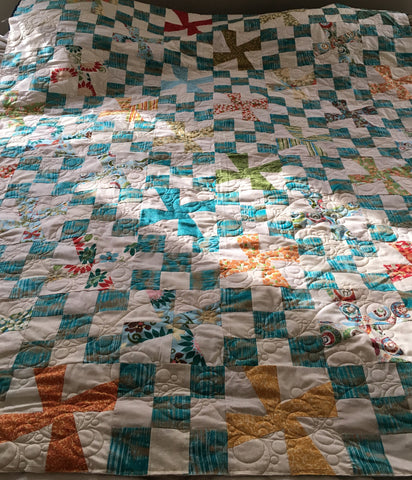 pinwheel and nine block with lather rinse repeat quilt design