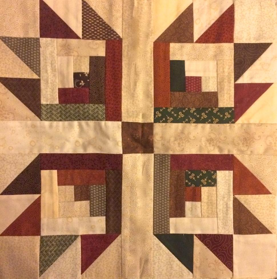 Log cabin quilt block bear paw quilt block
