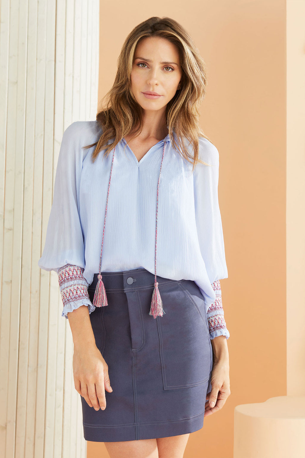 Model wearing the Carmen blouse in Periwinkle.