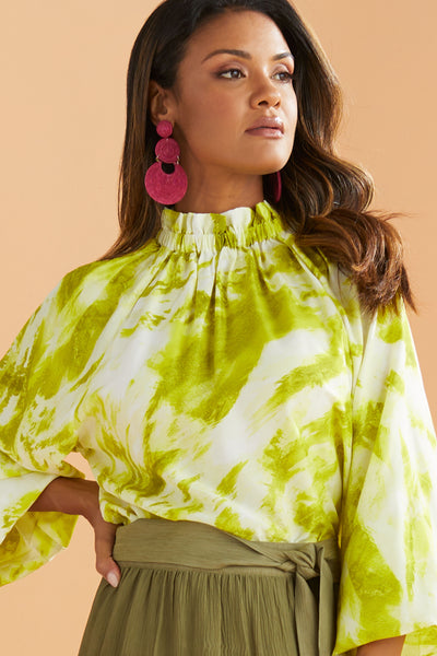 June Blouse in Citrus tie dye features a high neckline and long sleeves.