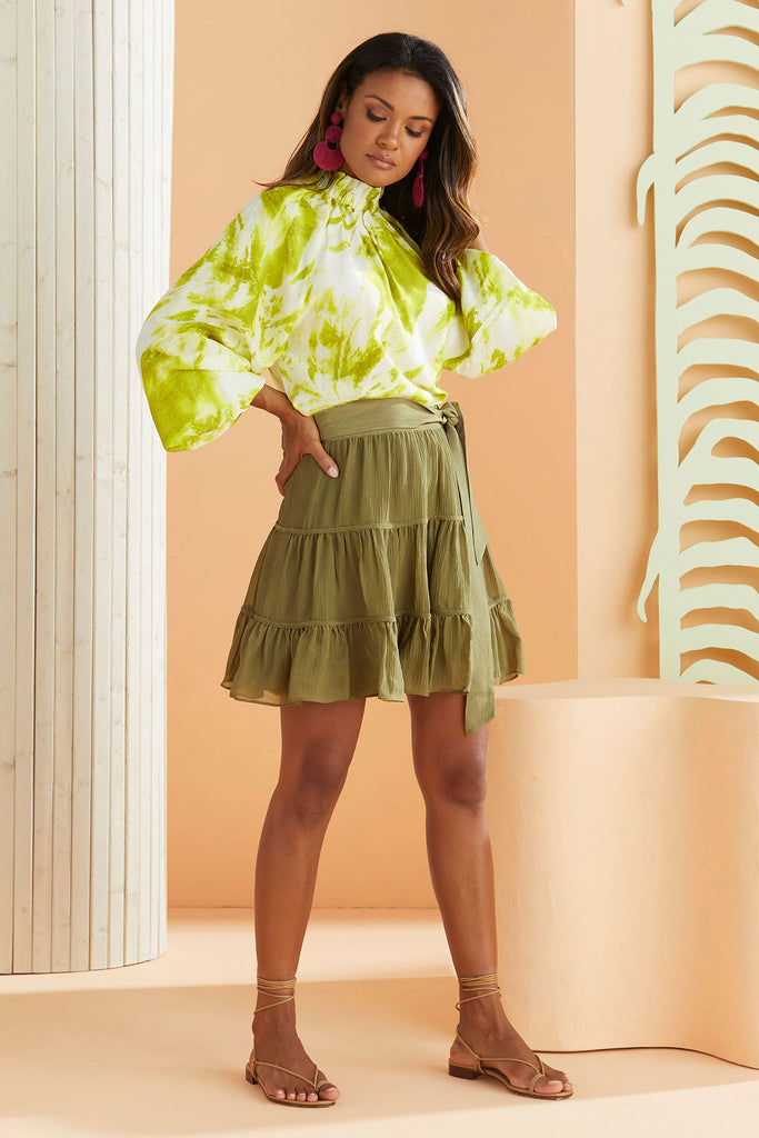 The bess skirt in olive green worn with the lime green reagan resort top