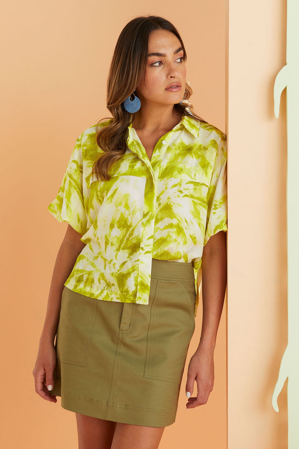 braden skirt in olive worn with the Reagan Resort shirt in lime citrus green