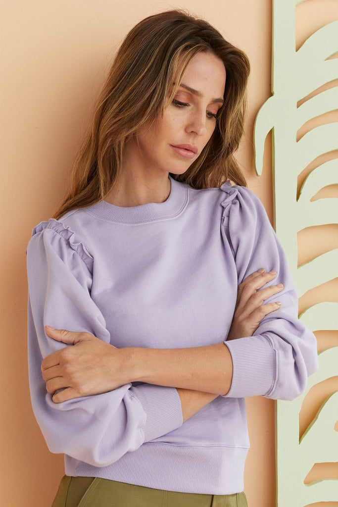 Lilac sweatshirt with ribbed cuff and gathered sleeve.