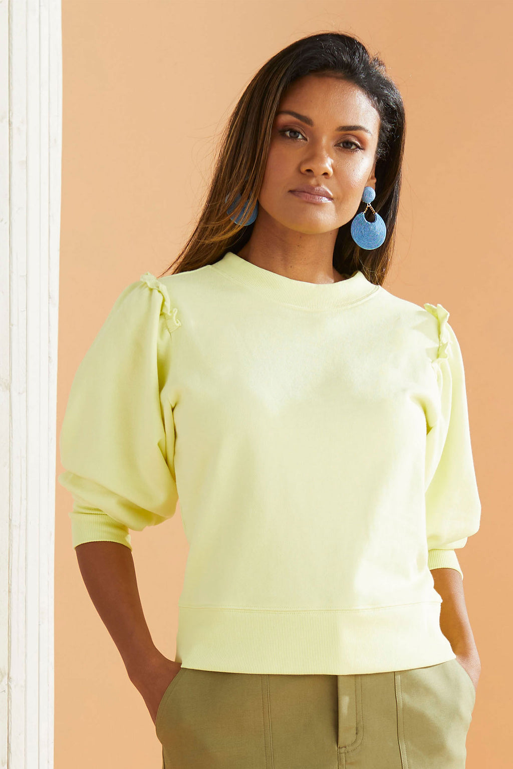 Lime Sweatshirt with ruffle detailing on shoulder