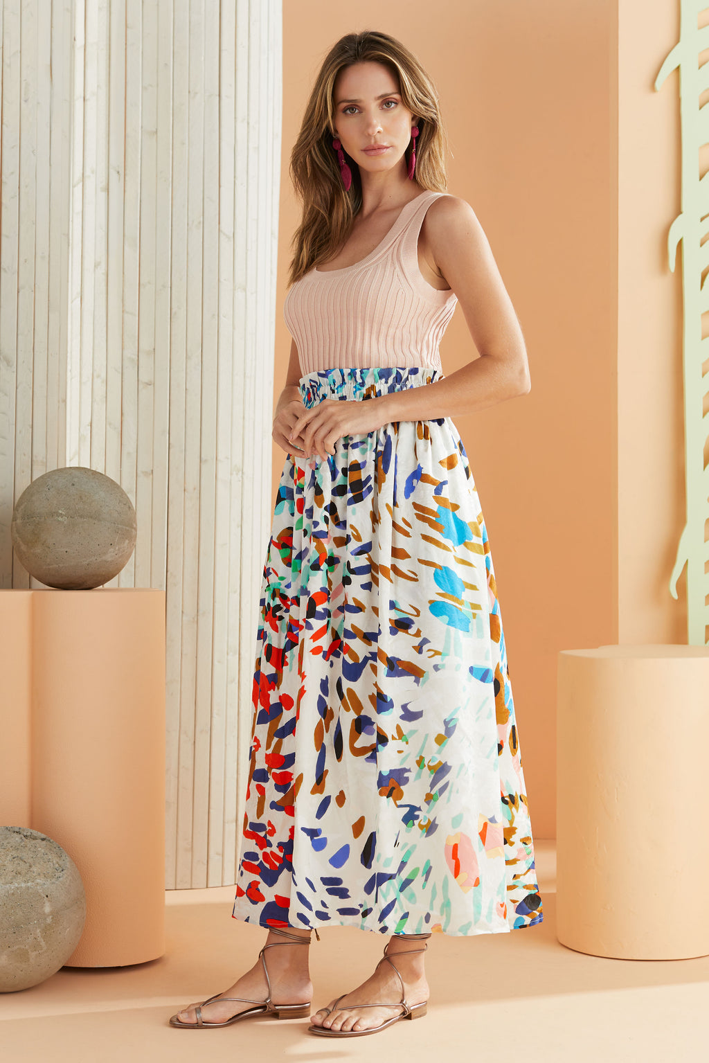 colorful animal print maxi skirt worn with pink ribbed tank