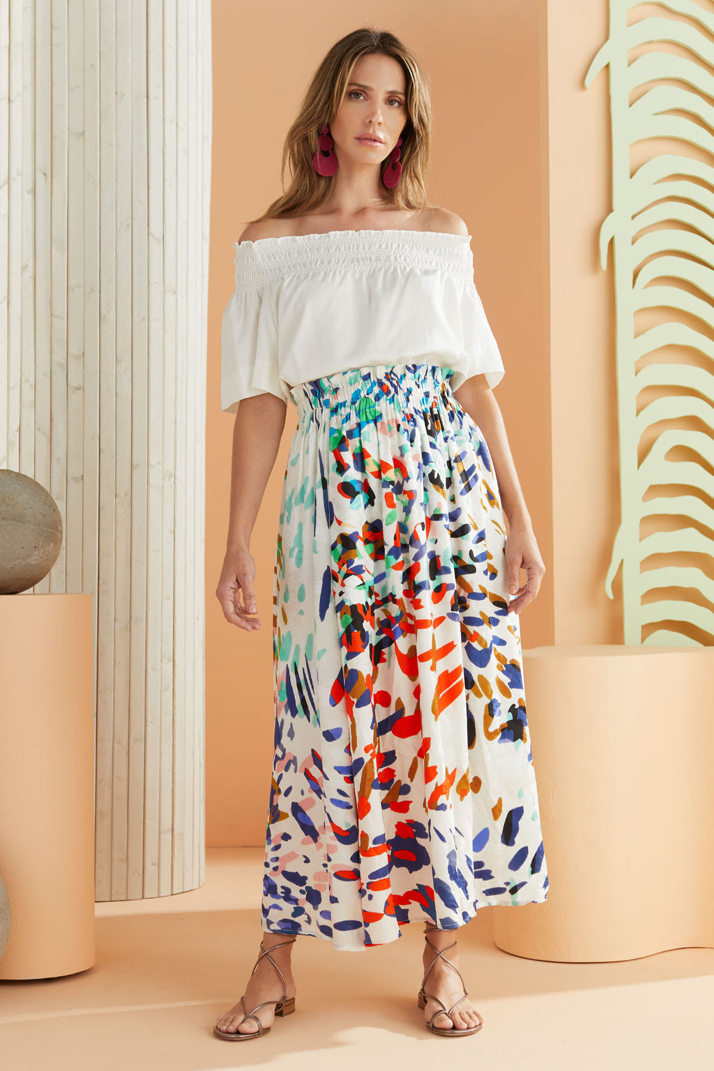 multi colored animal print skirt worn with white top