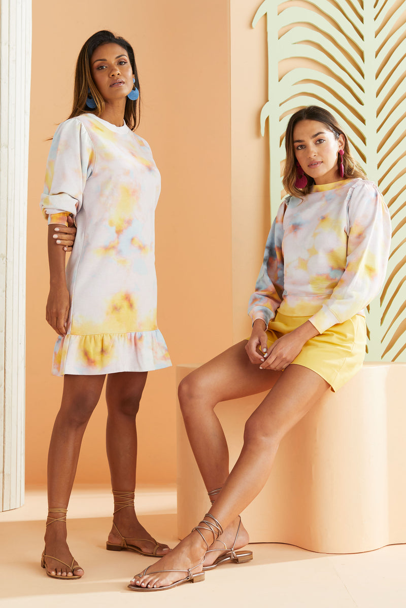 two models wearing soft pastel tie dye. One sweatshirt dress and one fashion sweatshirt