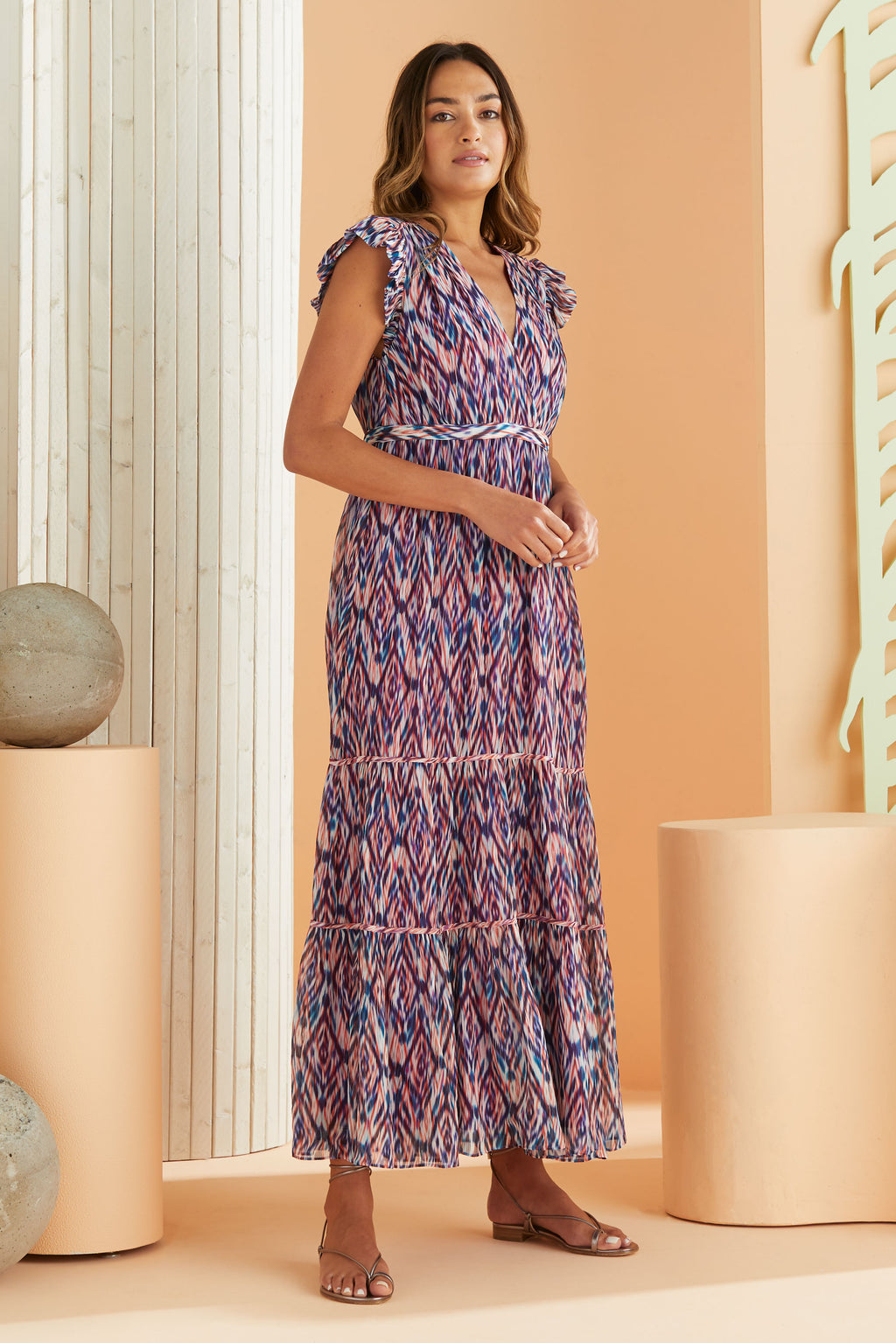 model wearing maxi dress with ikat print