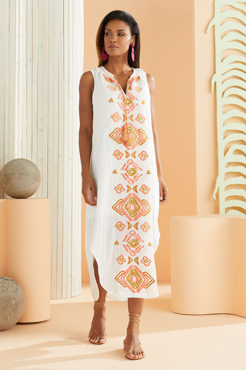 model wearing sleeveless maxi dress with shirt tail hem in white with our multi color Ikat embroidery