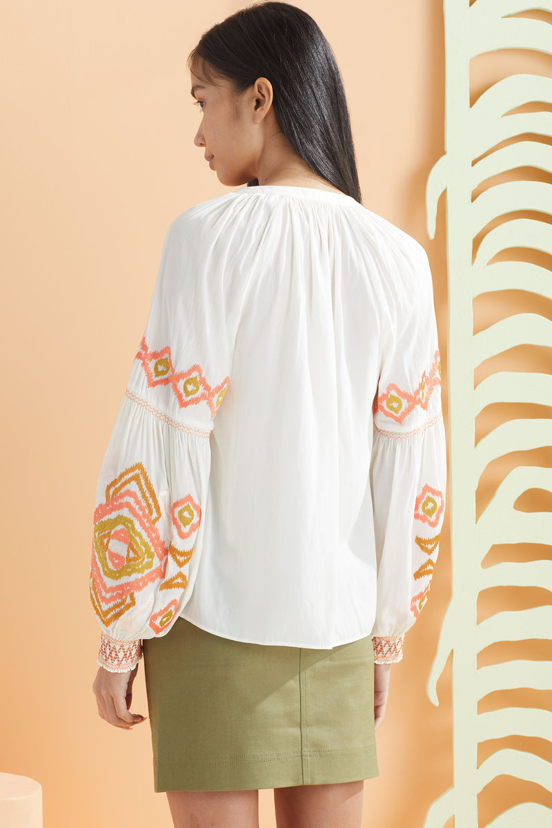 white long sleeve blouse with embroidery details back view