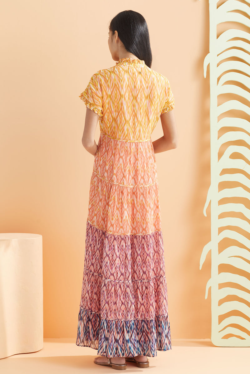 short sleeve tiered maxi dress in multi color print back view