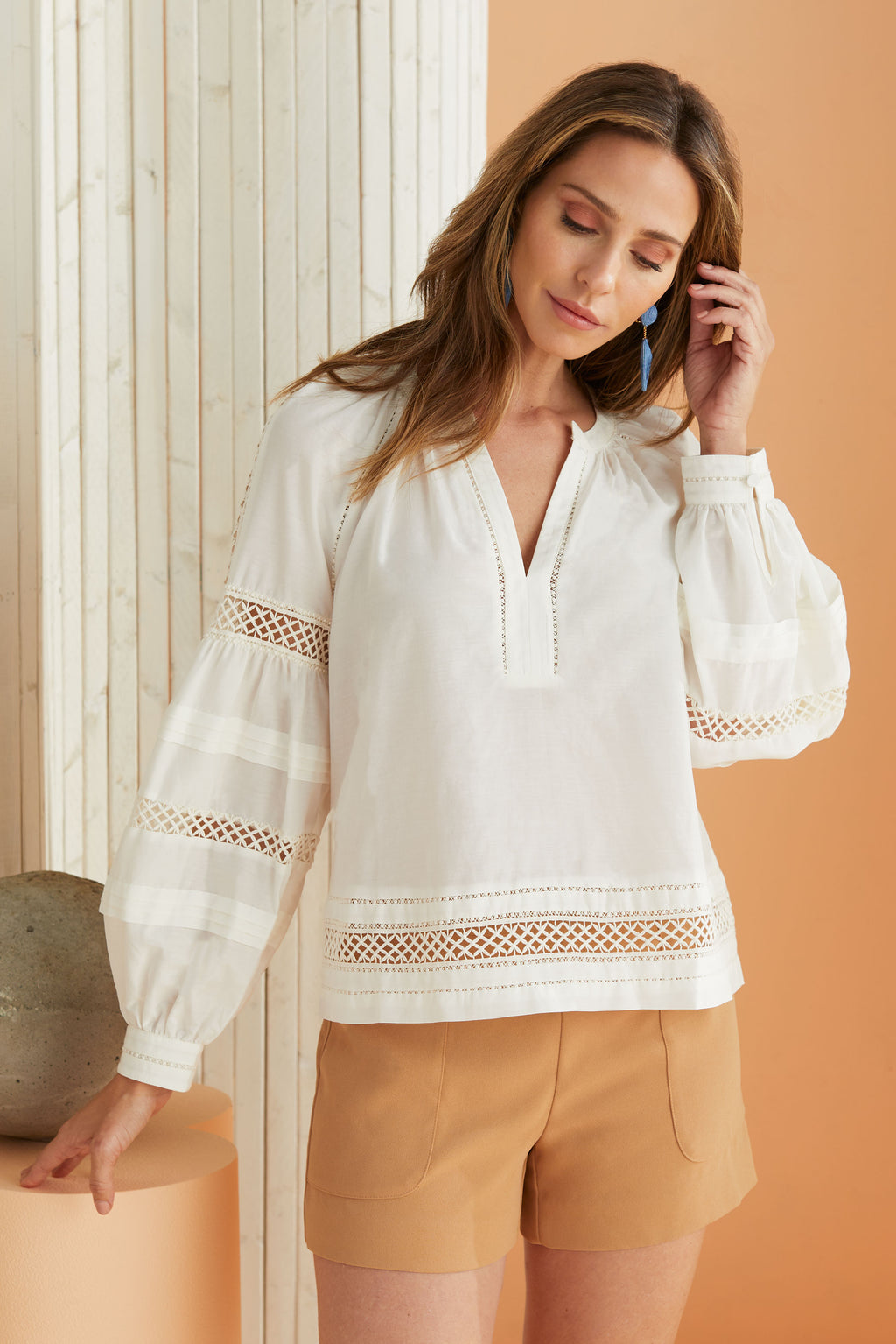 White v-neck long sleeve blouse with lattice details