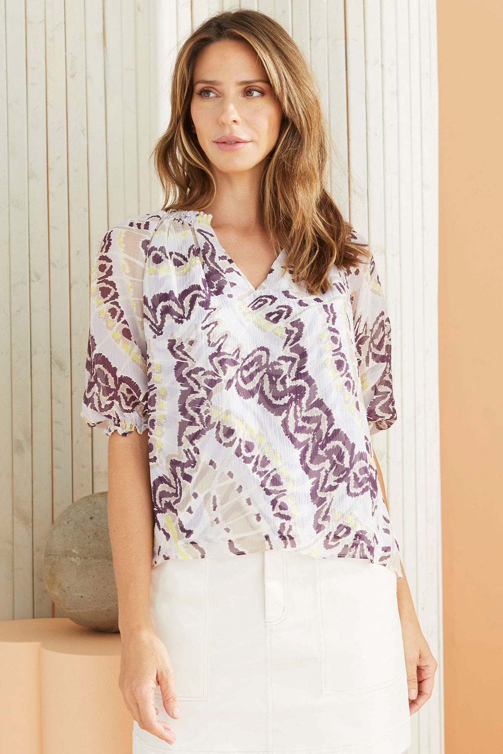 Model wearing the Kori Blouse in our Berry Butterfly print