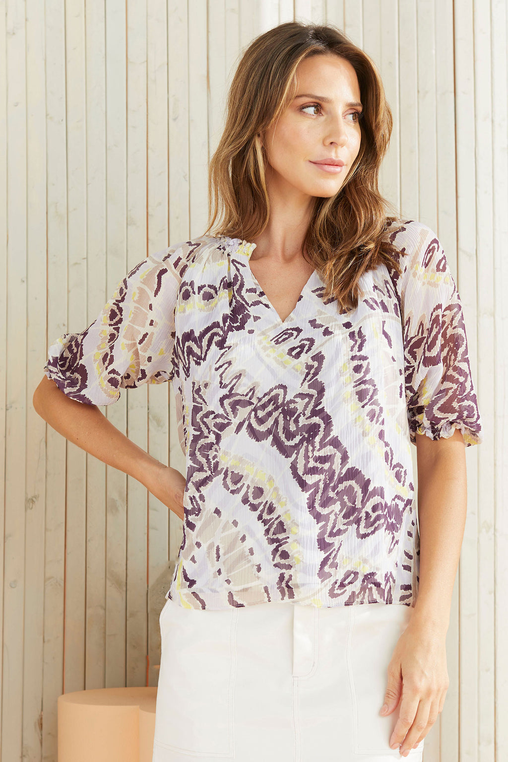 Kori Blouse in Berry butterfly worn with the Braden in Cool White.