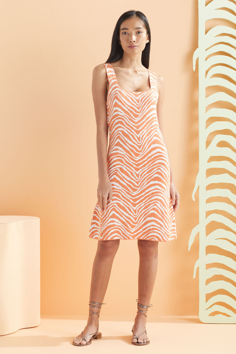 Sleeveless slip on dress that hits above the knee in our orange and white print