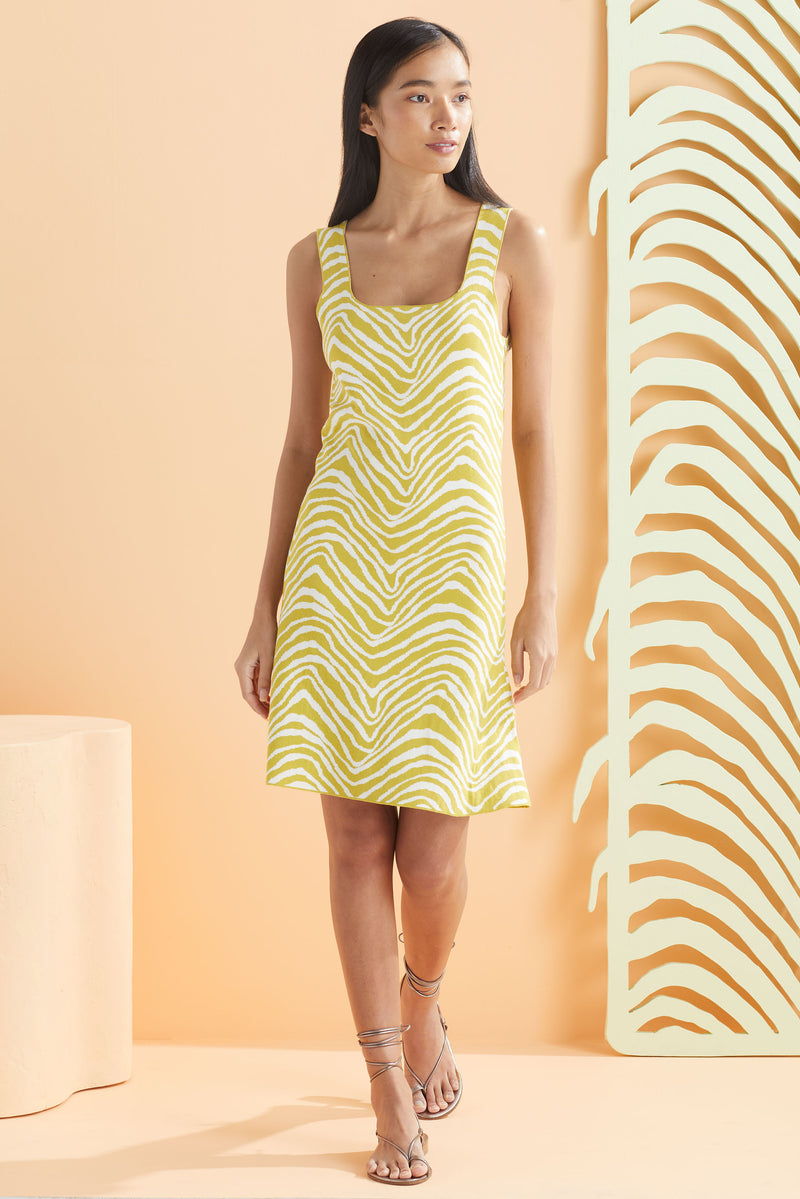 Sleeveless slip on dress that hits above the knee in our light green and white print