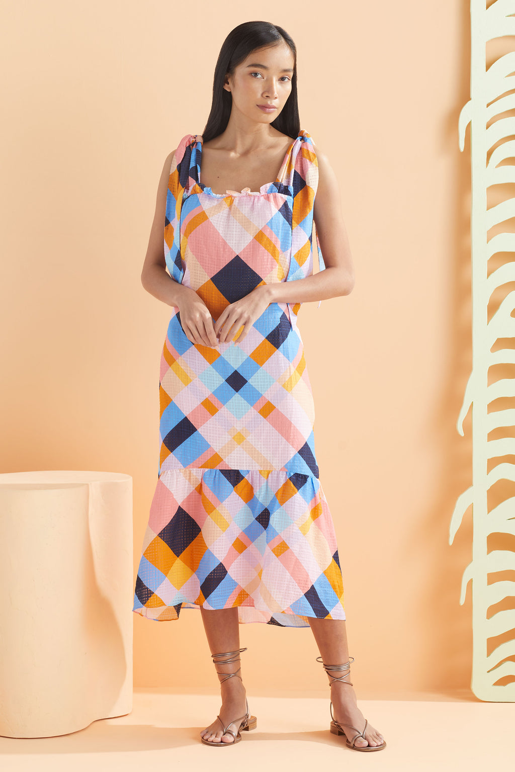 Midi sleeveless dress with hints of blue, pink, and orange.