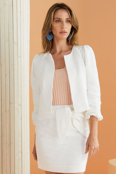 white cropped jacket and matching skirt set