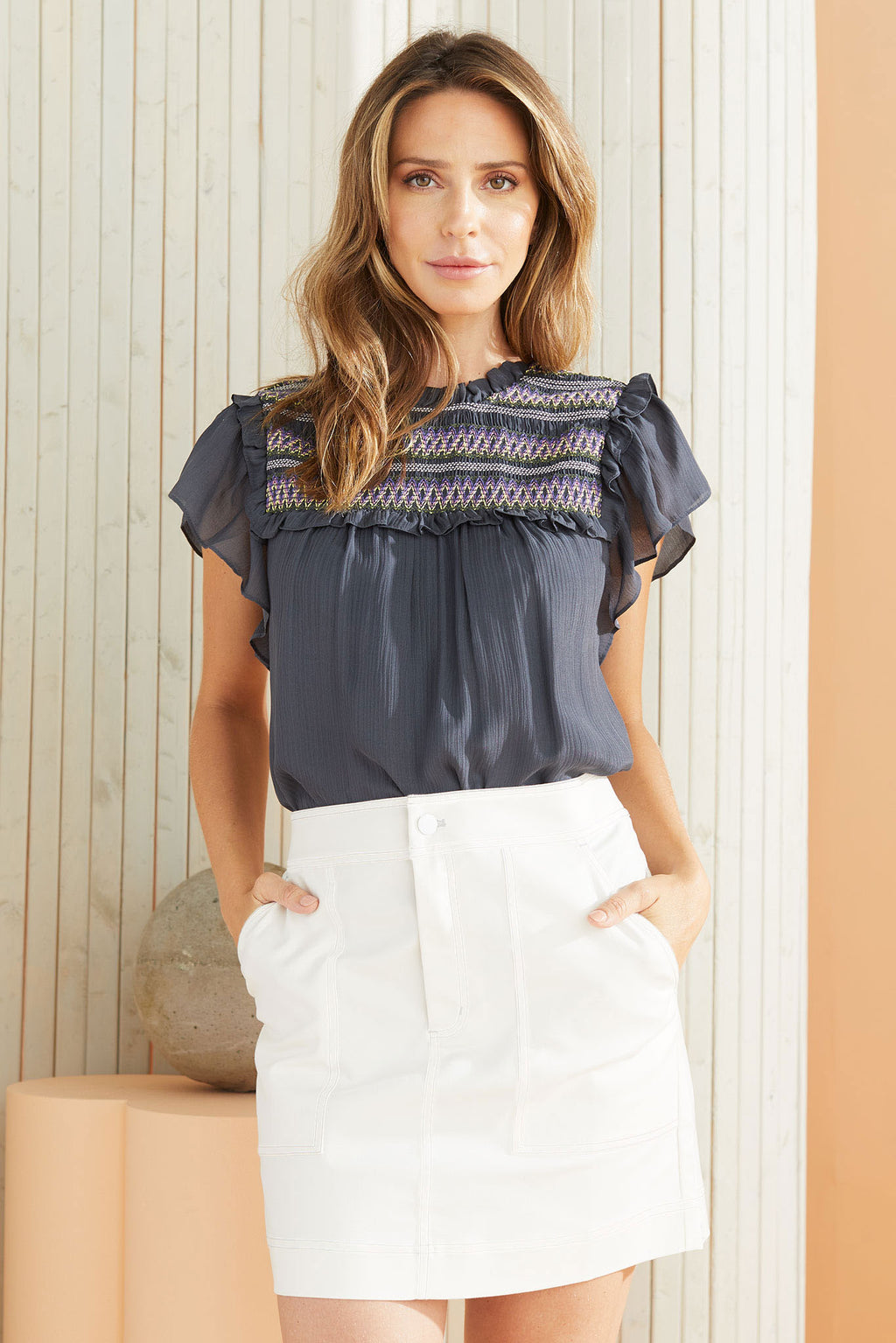 Short Sleeve Smocked navy Top worn with white skirt