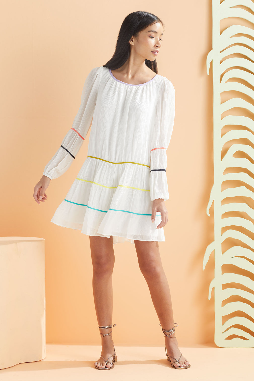 White long sleeve dress with colorful details  and an optional belt.